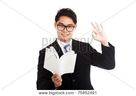 Asian Businessman Read A Book Show Ok Sign