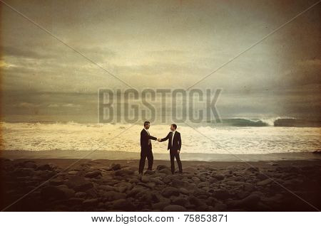 Businessmen Shaking Hands by the Beach