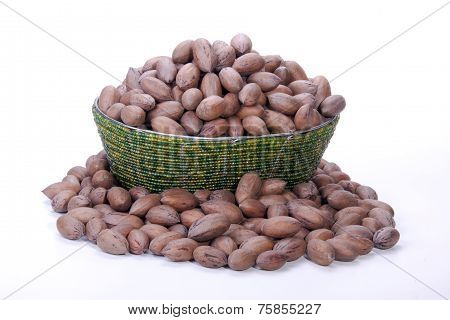 Pile Of Unshelled Pecan Nuts In Beaded Zulu Basket