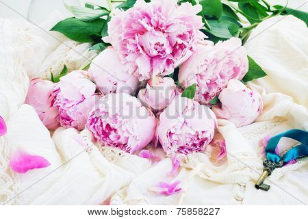 pink peony flowers with key