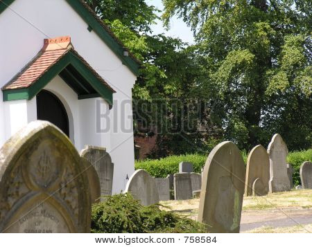 White chapel in graveyard