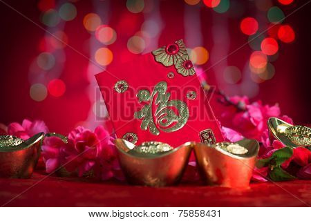 Chinese new year festival decorations, ang pow or red packet and gold ingots. Chinese character means