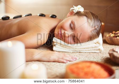 Peaceful woman enjoying spa procedure