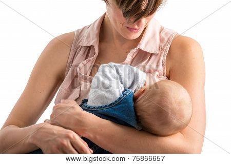 Devoted Young Mother Breastfeeding Her Newborn Baby