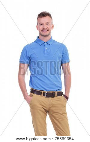 picture of a young casual man with his hands in his pockets, smiling for the camera. isolated on a white background