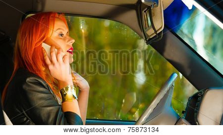 Girl Talking On Mobile Phone While Driving The Car.