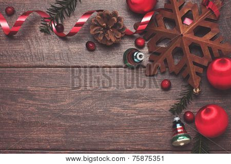 Vintage Ornaments And Evergreen On Wood