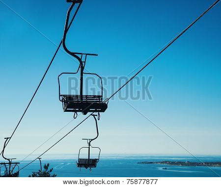 Cableway On Background Of Blue Sky