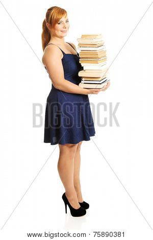 Overweight woman holding heavy books.