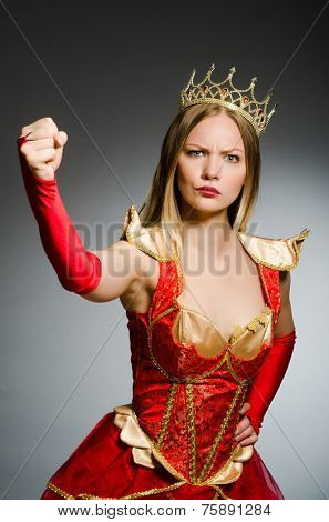 Angry queen against dark background
