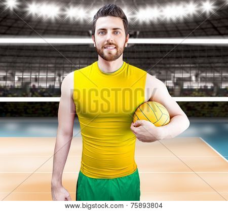 Volleyball player on yellow and green uniform on volleyball court