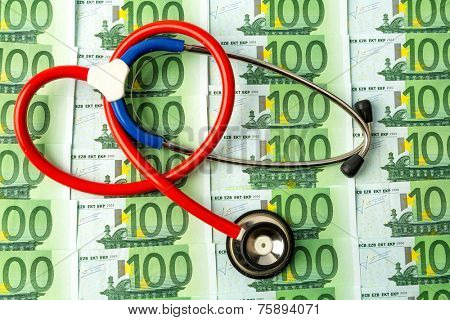 stethoscope and euro banknotes. symbol photo for costs in health care and health insurance for medical and