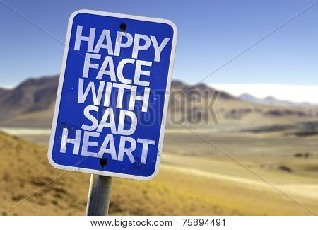 Happy Face With Sad Heart sign with a desert background