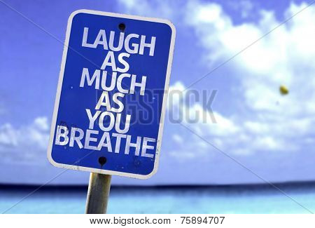 Laugh As Much As You Breathe sign with a beach on background