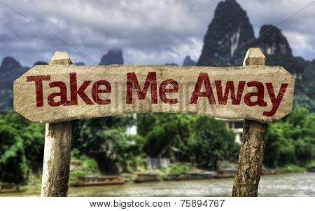 Take me Away sign with a forest background