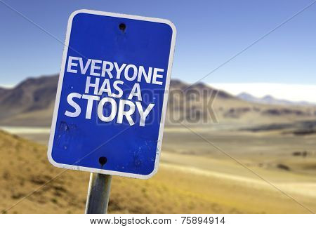 Everyone Has a Story sign with a desert background