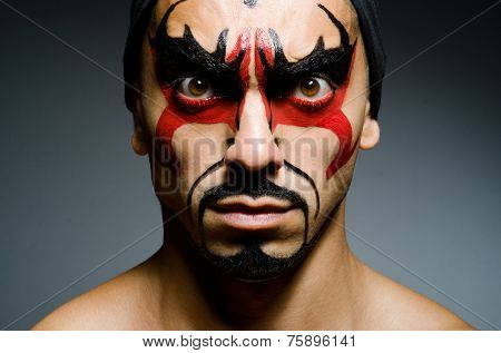 Man with face covered with facepaint
