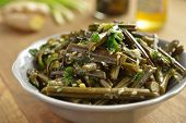 stock photo of fern  - Sauteed bracken fern with sesame oil and seeds - JPG