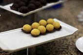 image of cake-ball  - Yellow ball cakes on a plate at the buffet - JPG