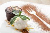 foto of ice-cake  - Warm dessert chocolate cake Fondant served on plate with ice - JPG