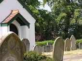 White chapel in graveyard
