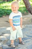 foto of laughable  - Baby walking in the park - JPG