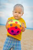 picture of laughable  - Baby playing with toy ball - JPG