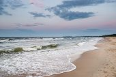 foto of polonia  - Sunset over Baltic Sea beach in Karlikowo District in Sopot Poland - JPG