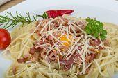 pic of carbonara  - Pasta Carbonara with tomato rosemary and basil leaves - JPG