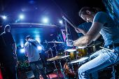 image of drum-set  - Drummer playing on drum set on stage - JPG
