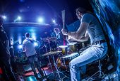 stock photo of drum-set  - Drummer playing on drum set on stage - JPG