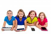 image of sisters  - sisters cousins kid girls with tech tablets and smartphones in a row lying on white background - JPG