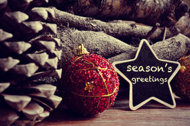 stock photo of star shape  - the text seasons greetings written in a star - JPG