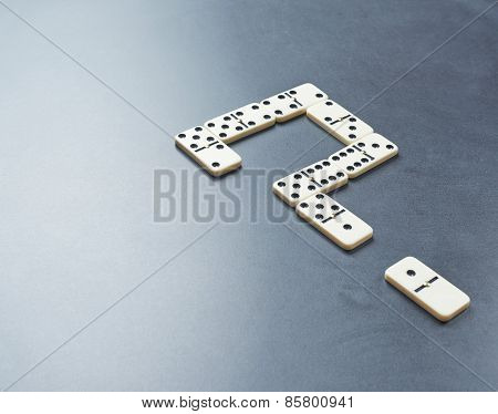 Question mark made with dominos