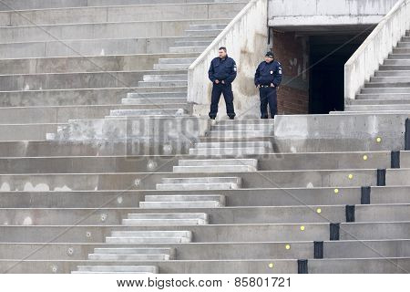 Two Police Officers On Their Post