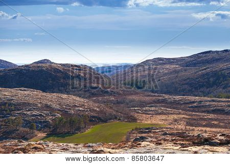 Norwegian Spring Landscape With Dark Mountains