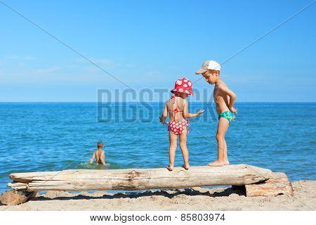 beach children play swimming costume summer vacations