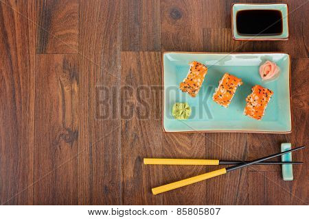 Sushi Rolls On The Wooden Table. Top View.