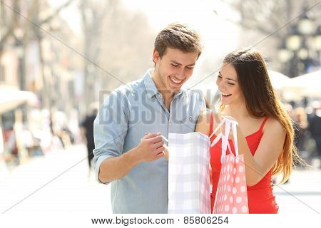 Couple Shopping And Holding Bags In The Street