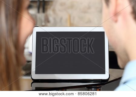 Couple Watching And Showing A Blank Tablet Screen