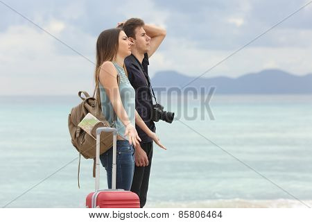 Tourists Frustrated With The Bad Weather On The Beach