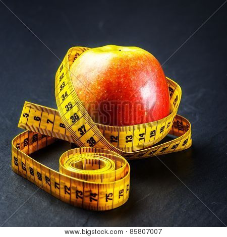 Apple With Yellow Measuring Tape