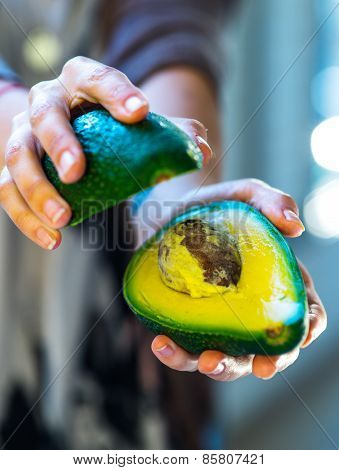 avocado in a hand of woman