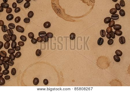 coffee beans and cup spot on kraft background