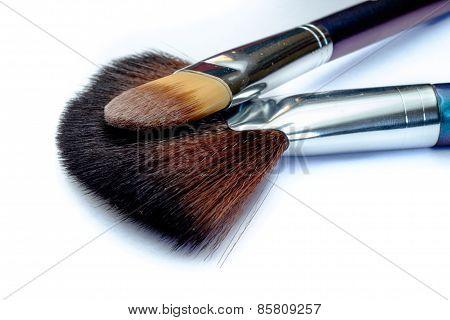 Closeup of 2 makeup brushes