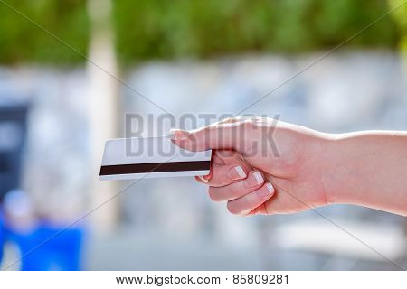 Female holding a credit card