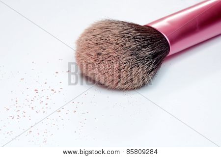 Closeup of makeup brush and powered blush