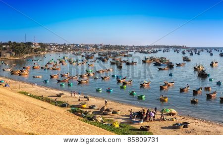 MUI NE, VIETNAM - FEBRUARY 08, 2014:i Fishing village and colorful fishing boats near Mui Ne at a su