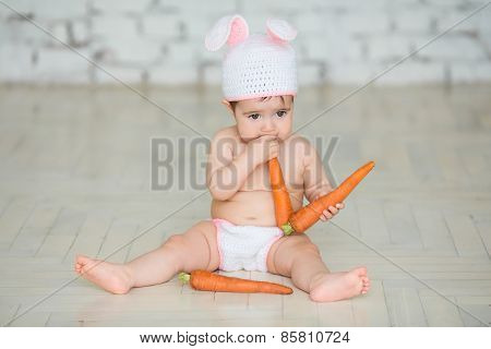 Portrait Of A Cute Baby Dressed In Easter Bunny Ears