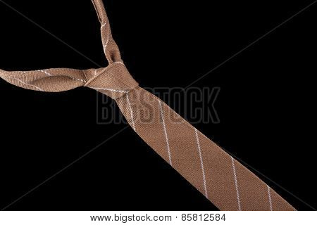 Brown necktie in wool with white stripes